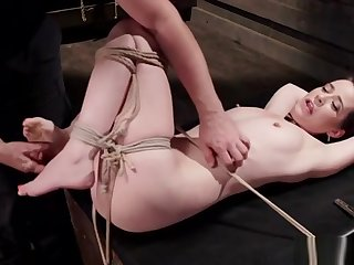 Slave in crotch rope slavery gets spanked