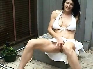 Sinewy MILF masturbates and squirts