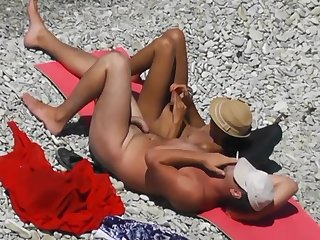 Voyeur. Girl Jerks Off dick her boyfriend at one's fingertips a public shore