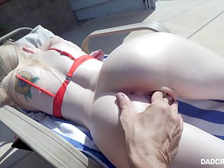 Sunbathing stepdaughter Lexi Lore gives a deepthroat blowjob by eradicate affect poolside