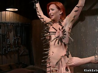 Redhead slave gets whole body clamped