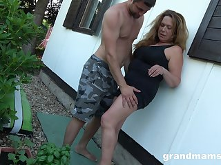 Obsessed with sex granny enjoys duplicitous sex with young gardener