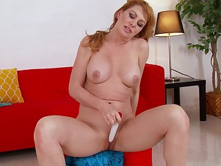 Redhead mature Sasha Sean drops her panties to play with her pussy